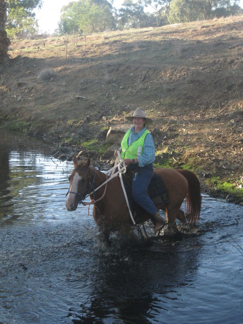 Lesley Hargrave crossing a creek during the ATHRA accreditation weekend at Manildra