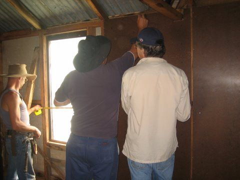 The guys hard at work in the hut, lining walls and ceiling.  I think it's smoko time, Rhona's legendary slice and cup of tea are calling