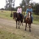 Marg on Cossie and Al riding Boo